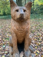 Wooden sculpture of a dog